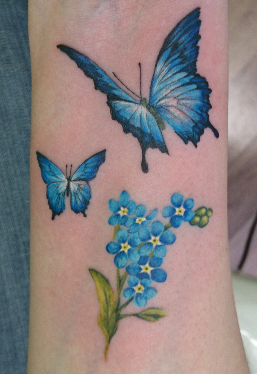 Schmetterling blau Arm